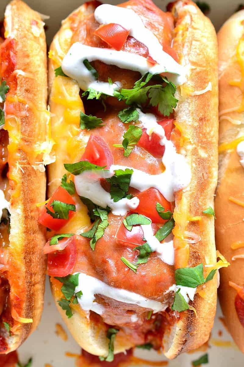 These Enchilada Meatball Subs combine two family favorites in one delicious dish that's easy to make and perfect for busy weeknights or game days!