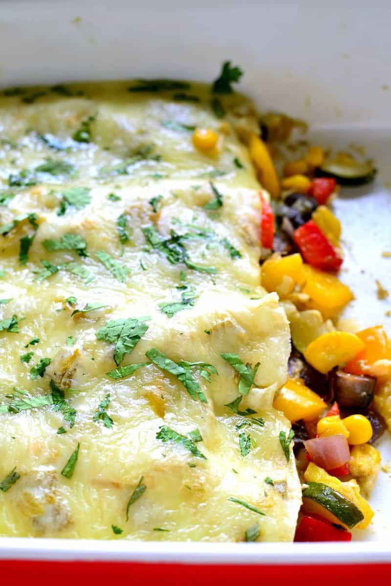 These Roasted Vegetable Enchiladas are packed with fresh veggies, corn, and black beans, then topped with a creamy chile verde sauce and melted Monterey Jack cheese. The perfect option for a healthy, flavor packed, meatless dinner!
