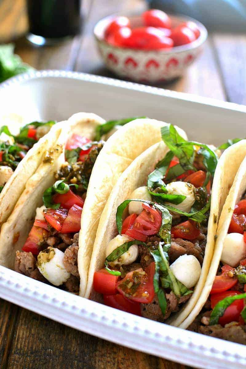 Soft Tacos filled with ground beef and the ingredients of a caprese salad