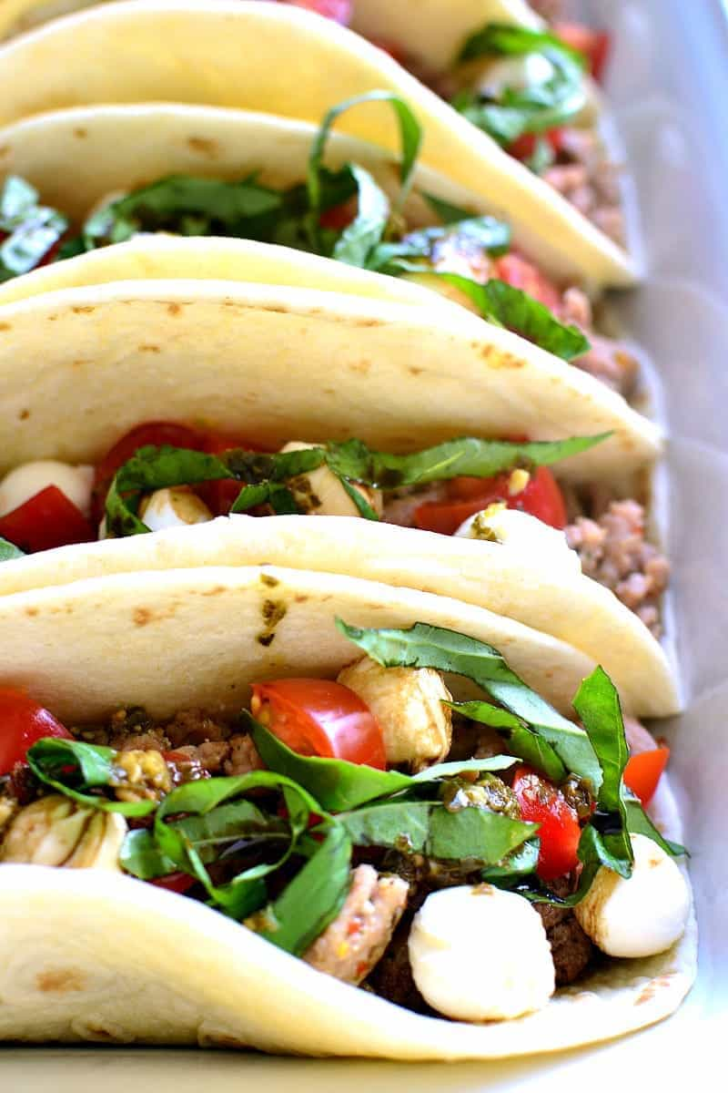Italian tacos made with fresh basil, tomatoes, and mozzarella cheese
