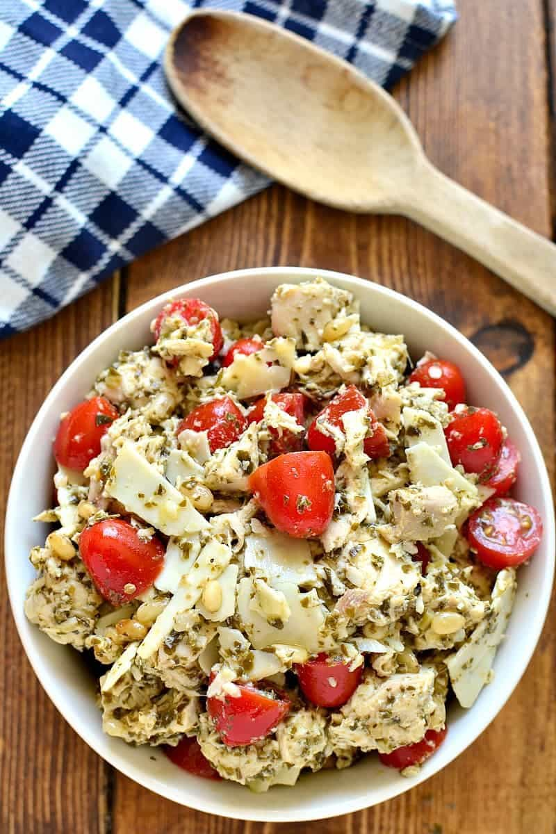 This Pesto Chicken Salad is loaded up with pine nuts, shaved parmesan, and fresh tomatoes. A delicious, flavor-packed twist on a classic....this chicken salad is perfect for spring!