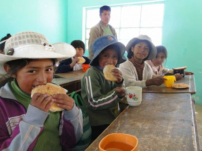 Bolivian school children eating their lunch