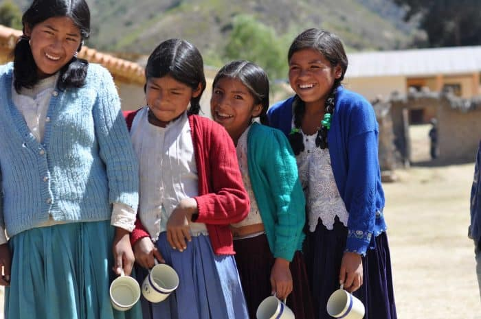 4 young smiling Bolivian girls