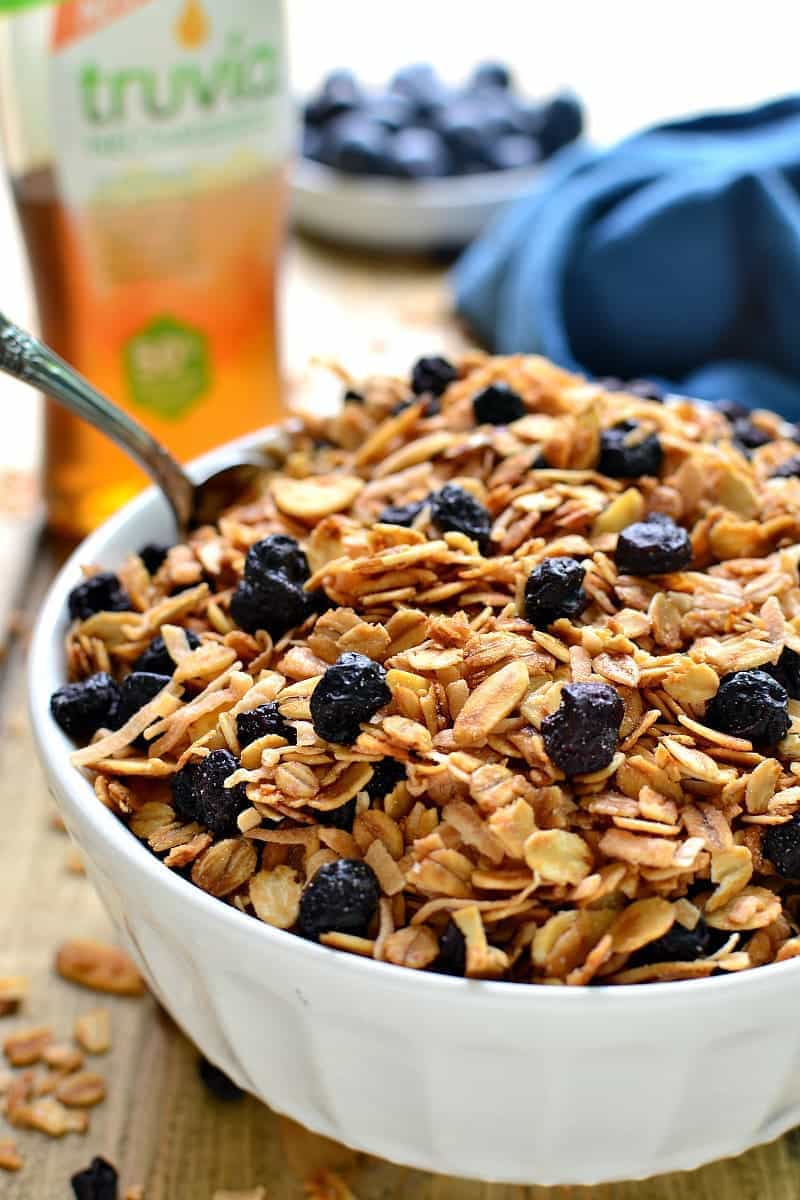 Homemade Blueberry Granola, packed with sliced almonds, toasted coconut, and dried blueberries. This granola is sweet, crunchy, and so delicious with yogurt, milk, or by the handful!