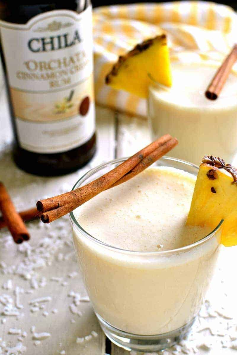 'Orchata Coladas combine the classic flavors of piña coladas with sweet Cinnamon Cream Rum in a drink that's creamy, delicious, and perfect for summer!