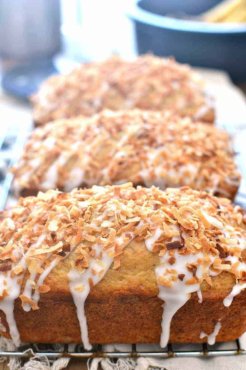 This Coconut-Rum Banana Bread starts with the BEST banana bread recipe and combines it with the delicious flavors of toasted coconut and real rum!