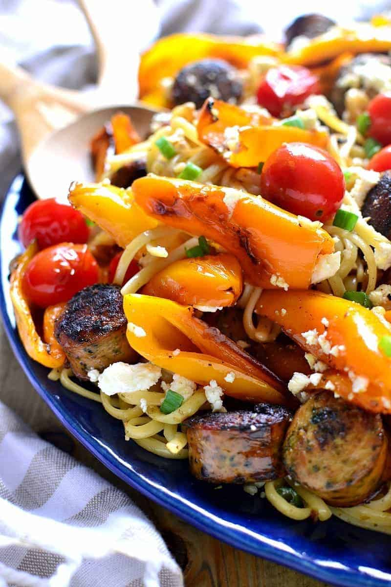 This Sausage & Pepper Linguine is chock full of vegetables and bursting with delicious flavor! Have it on the table in 30 minutes or less....this dish is perfect for busy nights and guaranteed to become a family favorite!