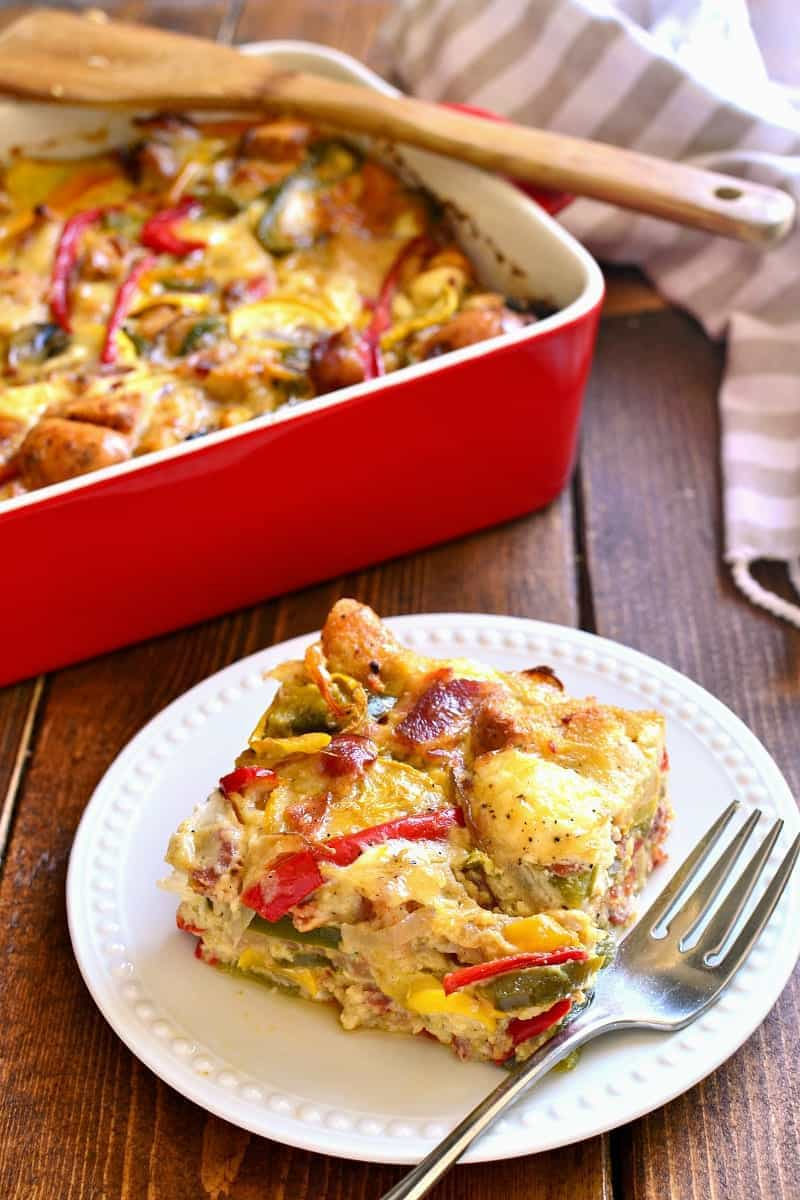 This Summer Vegetable Breakfast Strata is loaded with fresh summer vegetables, crusty bread, two types of cheese, and crispy bacon. Perfect for any special occasion - this is one of our favorites!