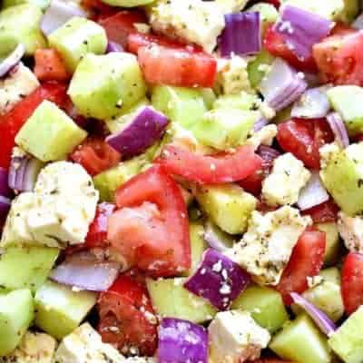 Tomato Cucumber Feta Salad is fresh, flavorful, and SO delicious! This easy summer salad recipe comes together quickly. with just a handful of ingredients.
