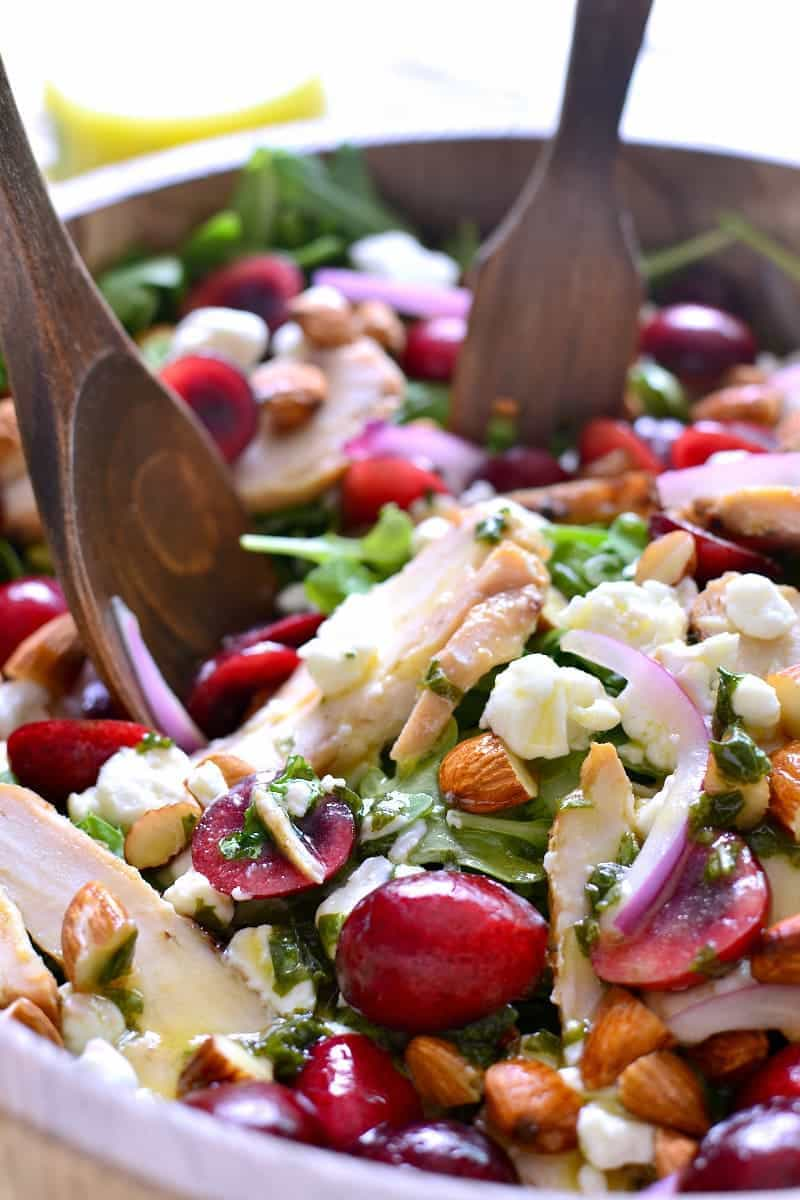 This Cherry Almond Arugula Salad combines fresh baby arugula with sweet cherries, almonds, goat cheese, and grilled chicken for delicious summer salad that's perfect as a main dish or on the side!