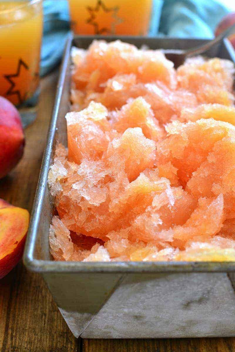 This Frozen Peach Slush is a delicious blend of citrus, peach tea, peach schnapps, and brandy...topped off with your favorite sparkling soda! Perfect for parties, special occasions, or lazy summer days. The perfect drink for summer!
