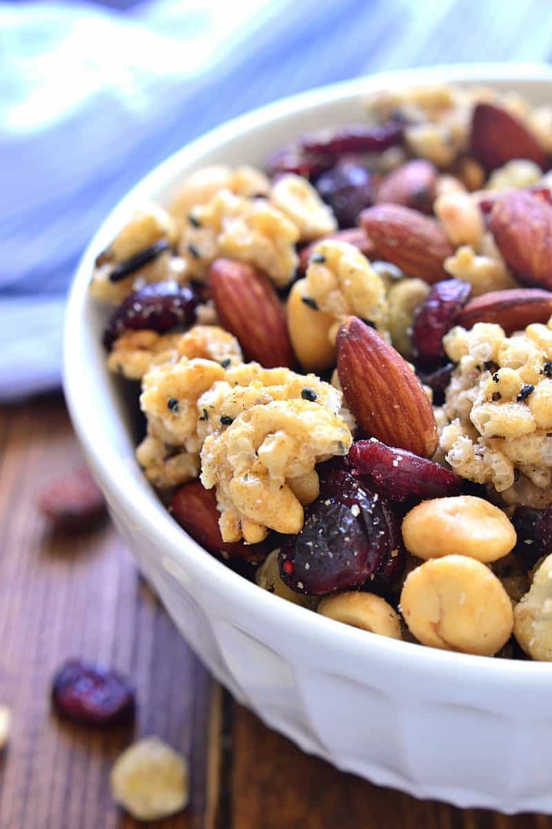 This Ginger Sesame Snack Mix combines the delicious flavors of sesame and ginger with roasted almonds, wasabi peas, salted peanuts, and dried cranberries. An unexpected blend of savory and sweet, this snack mix is bold, crunchy, and so addictive!