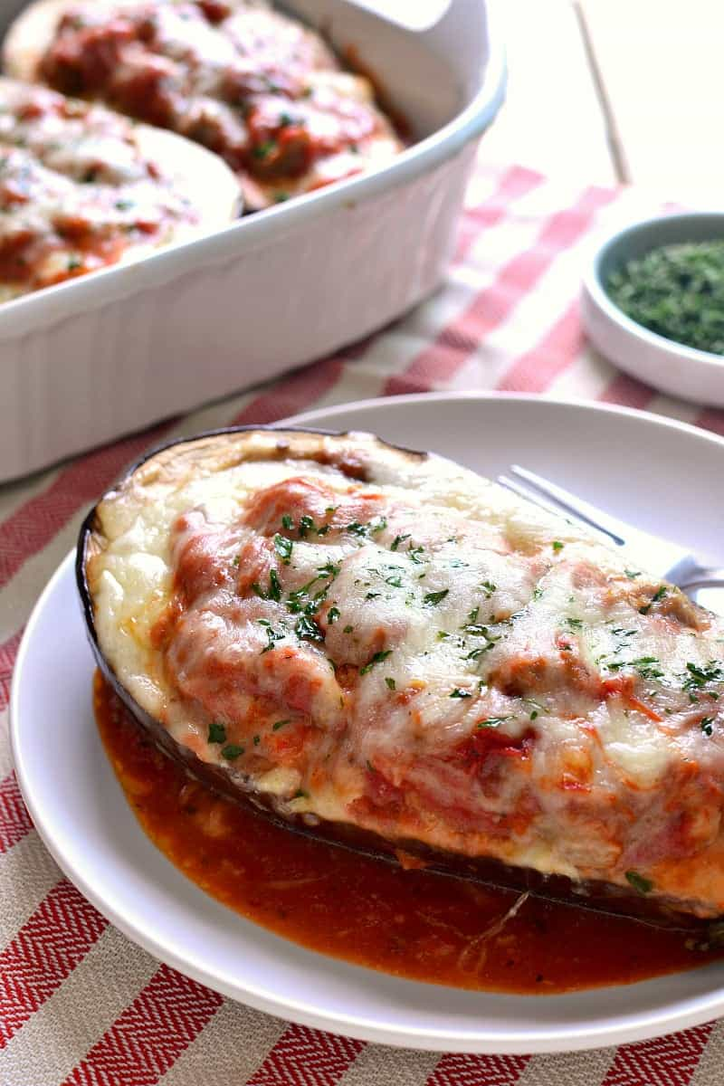 Lasagna Stuffed Eggplant makes the most of fresh summer produce by combining two classics in one delicious dish. Baked eggplant meets creamy lasagna and the result is pure comfort food that's perfect for summer!