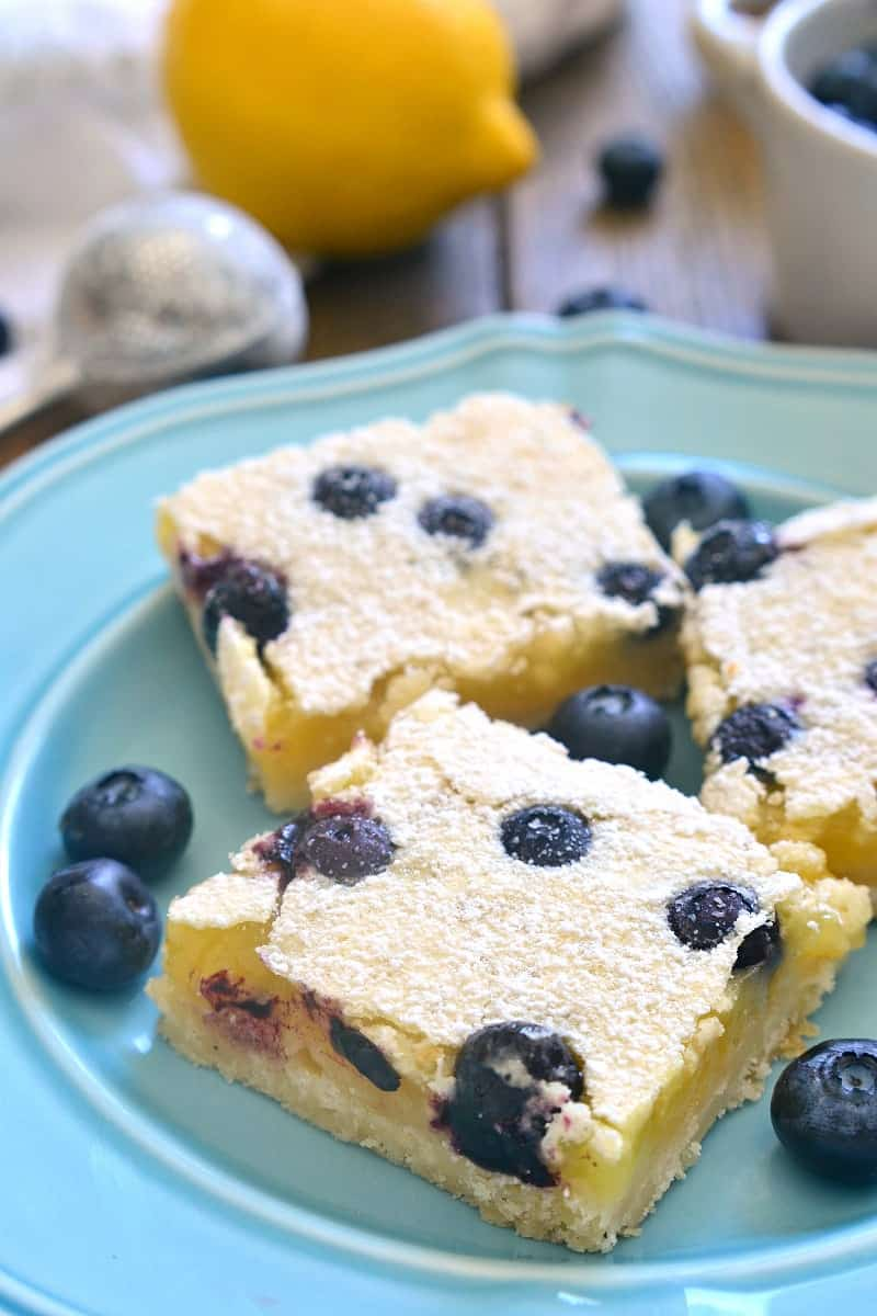 These Blueberry Lemon Bars take the classic bars to the next level with the addition of fresh blueberries! Deliciously sweet and perfect for summer!