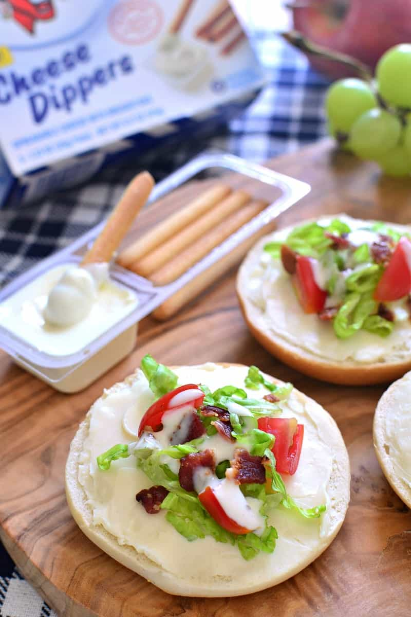 These BLT Bagel Bites make the perfect after school snack! Loaded with all the flavors of a BLT, plus the delicious addition of CHEESE....they come together quickly and are sure to be a hit!
