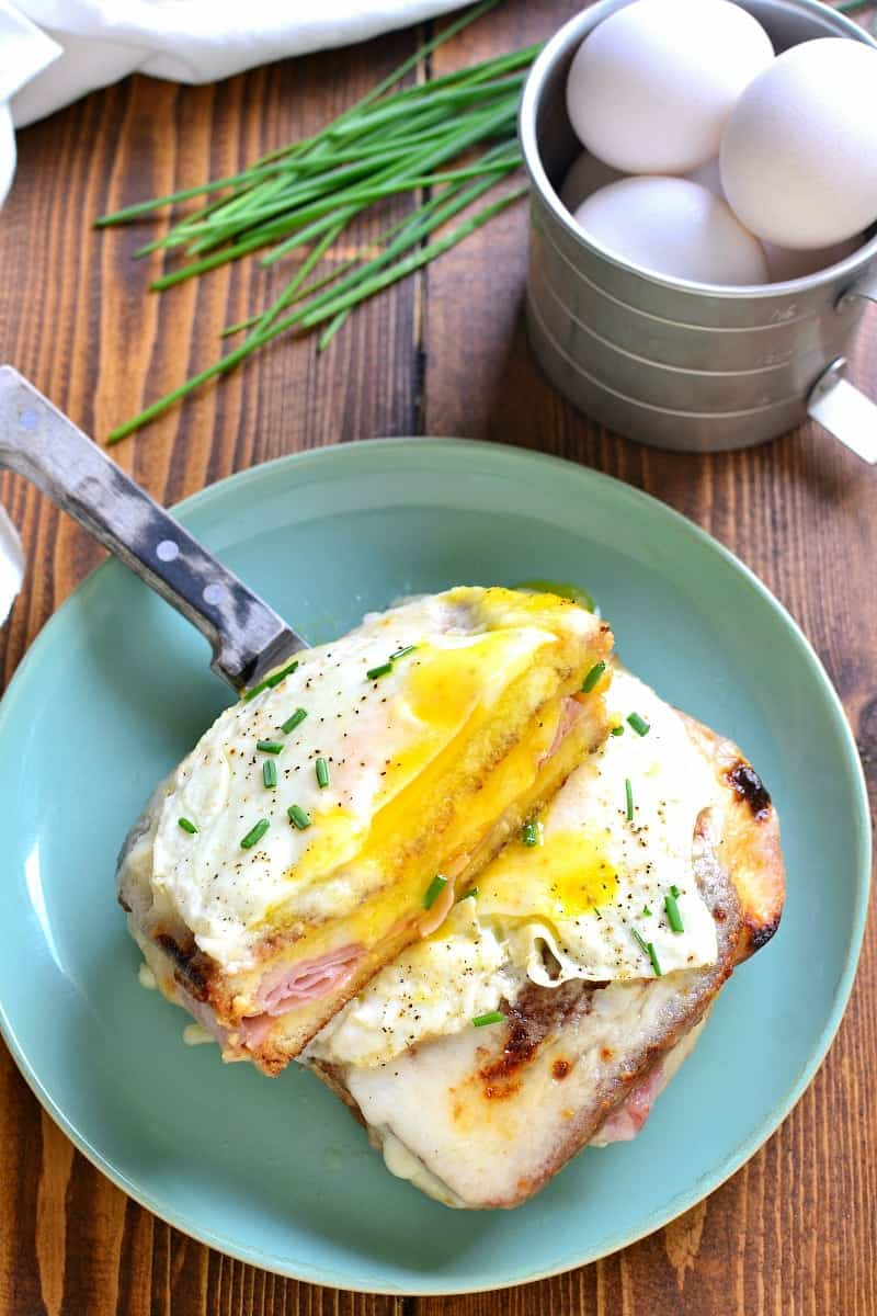 A Classic Croque Madame - made with sliced ham, swiss cheese, creamy béarnaise sauce, and a fried egg on top. Go ahead....indulge! It's worth it!