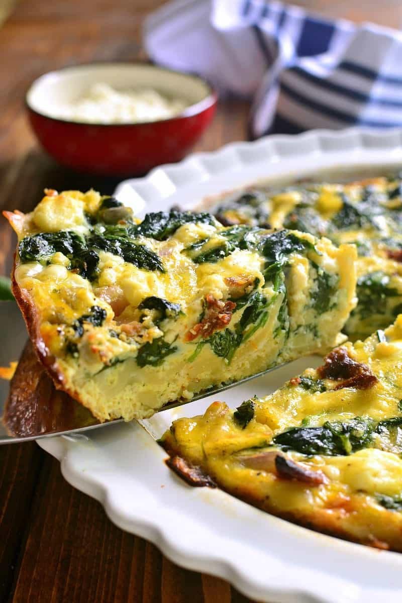 This Mediterranean Pasta Frittata is loaded with the delicious flavors of sun dried tomatoes, spinach, and feta cheese....and it's a great way to use up leftover pasta! Perfect for breakfast, lunch, or even dinner!