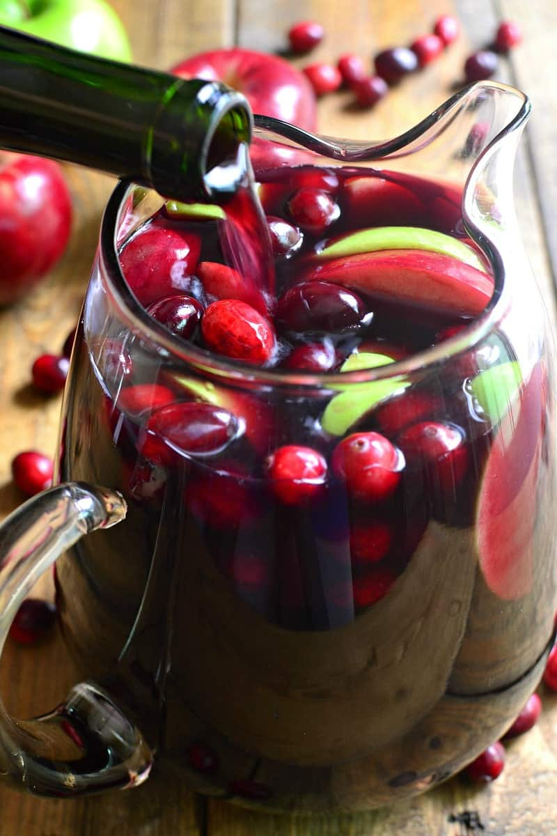 This Cranberry Apple Sangria is a deliciously sweet taste of fall! Loaded with fresh, seasonal fruit and packed with flavor, it's sure to become a new fall favorite! Perfect for the holidays, too!