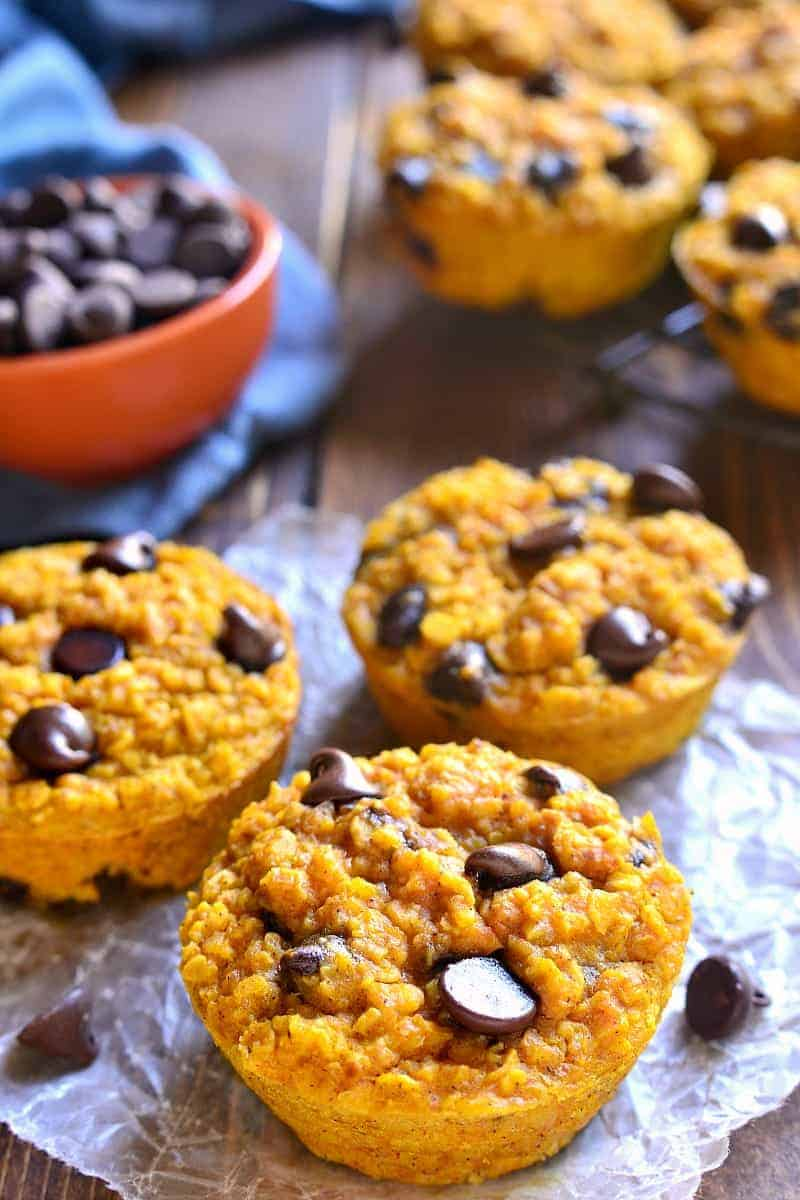 These Pumpkin Chocolate Chip Baked Oatmeal Muffins are just like the delicious baked oatmeal you love...in single serve portions! You'll fall in love with the pumpkin chocolate chip flavor in these yummy fall treats that are perfect for breakfast or snack time!