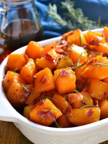 Maple Bacon Roasted Butternut Squash is sweetened with real maple syrup and mixed with crispy bacon. The perfect holiday side dish recipe