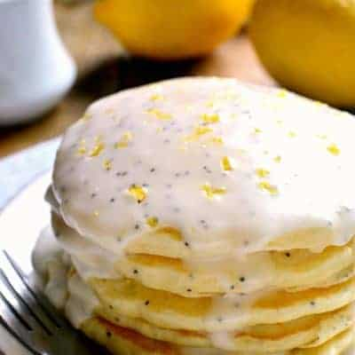 Lemon Poppy Seed Pancakes are light, fluffy, and bursting with lemon flavor! Easy breakfast pancakes to start your day off right. Try them with lemon poppy seed glaze for a sweet, tart, delicious start to your day.