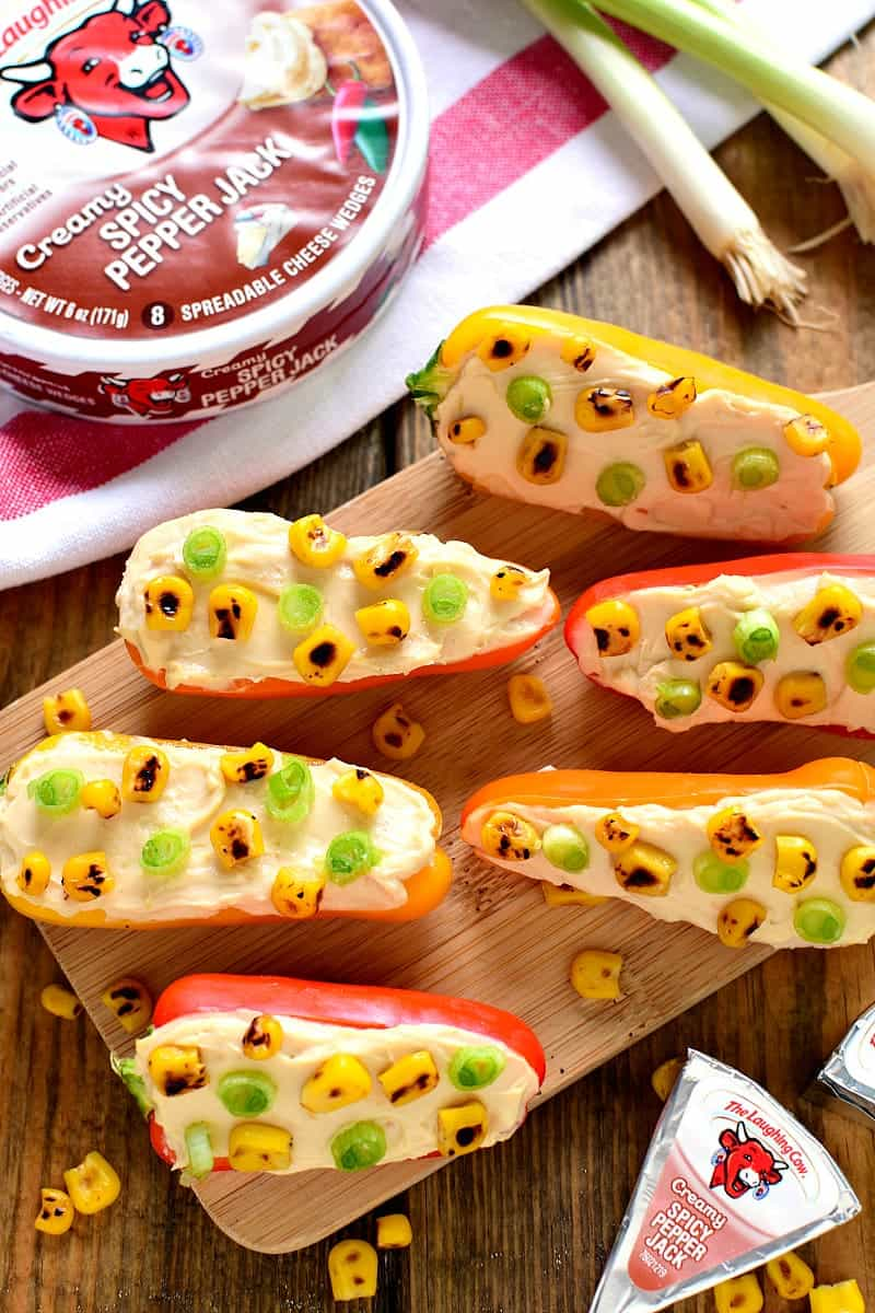 These Spicy Pepper Jack Poppers combine traditional southwest flavors of pepper jack cheese, grilled corn, mini peppers, and scallions in a fresh little bite that's bursting with flavor!
