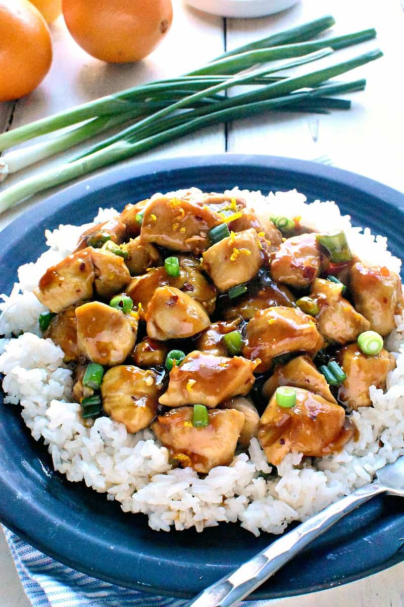 Skinny Orange Chicken - a delicious, lightened up version of your favorite takeout! This recipe comes together in 30 minutes or less and is guaranteed to satisfy the whole family!
