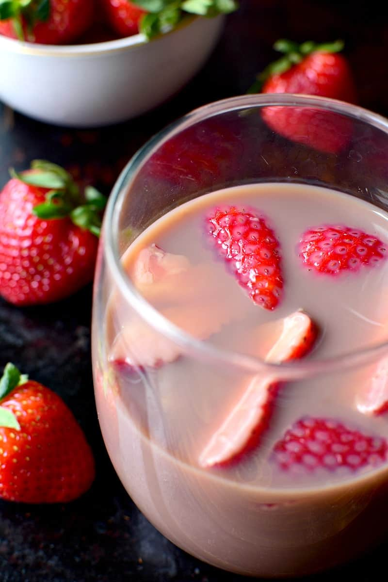 Chocolate Sangria - made with just 3 ingredients and garnished with fresh strawberries! This sangria is the ultimate rich, creamy, chocolatey cocktail....perfect for Valentine's Day or just because.