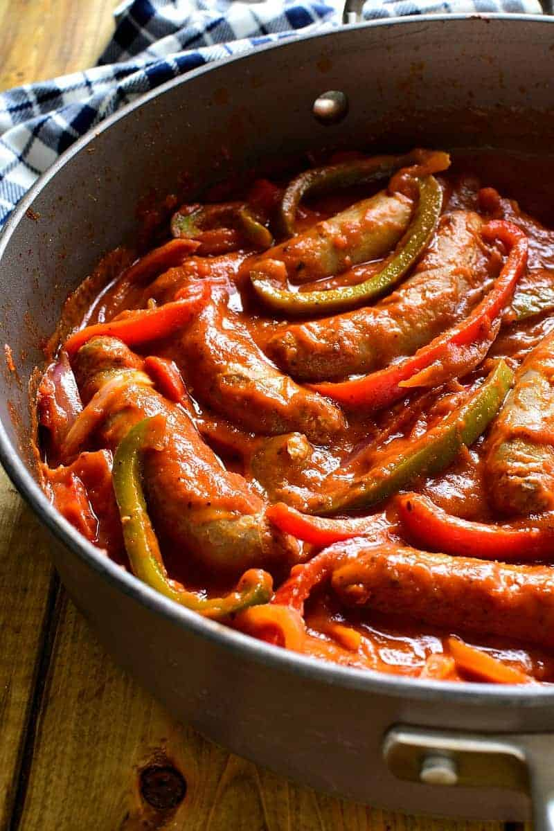 These Sausage & Pepper Sandwiches are like comfort in a sandwich roll! They combine the delicious flavor of Italian Sausages with fresh red & green peppers, onion, spices, and marinara sauce. Perfect for game days or easy weeknight dinners...they're sure to become a new family favorite!