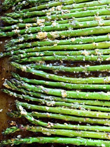 This Garlic Roasted Asparagus is packed with the delicious flavors of garlic and parmesan and is ready in 15 minutes or less!