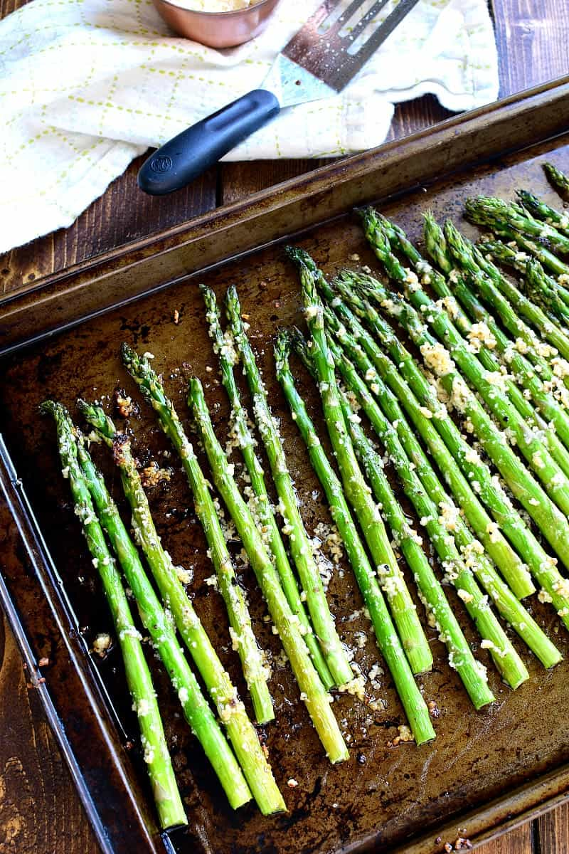 This Garlic Roasted Asparagus is packed with the delicious flavors of garlic and parmesan and is ready in 15 minutes or less! The perfect side dish for any meal....if you love garlic, this Garlic Roasted Asparagus is sure to become a favorite!
