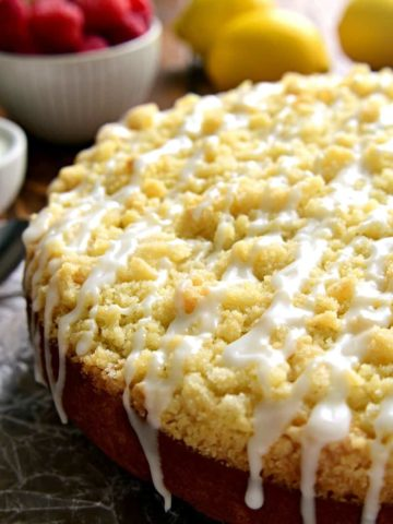This Lemon Raspberry Coffee Cake is the perfect cake for spring! This delicious coffee cake will enhance your brunch menu or with your next cup of coffee!