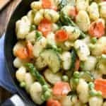 This Spring Vegetable Gnocchi is creamy, delicious, and comfort food at its finest. This gnocchi is loaded with fresh vegetables and comes together in under 20 minutes.