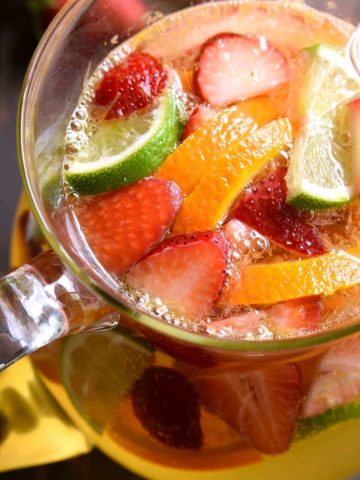 overhead image of a pitcher of skinny sangria with fresh fruit floating in it