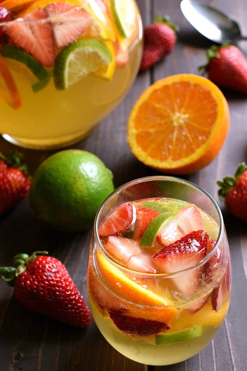 overhead image of a glass and pitch of summer fruit sangria