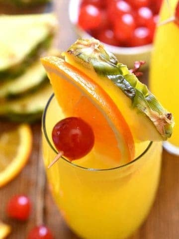 tropical mimosas garnished with fresh fruit
