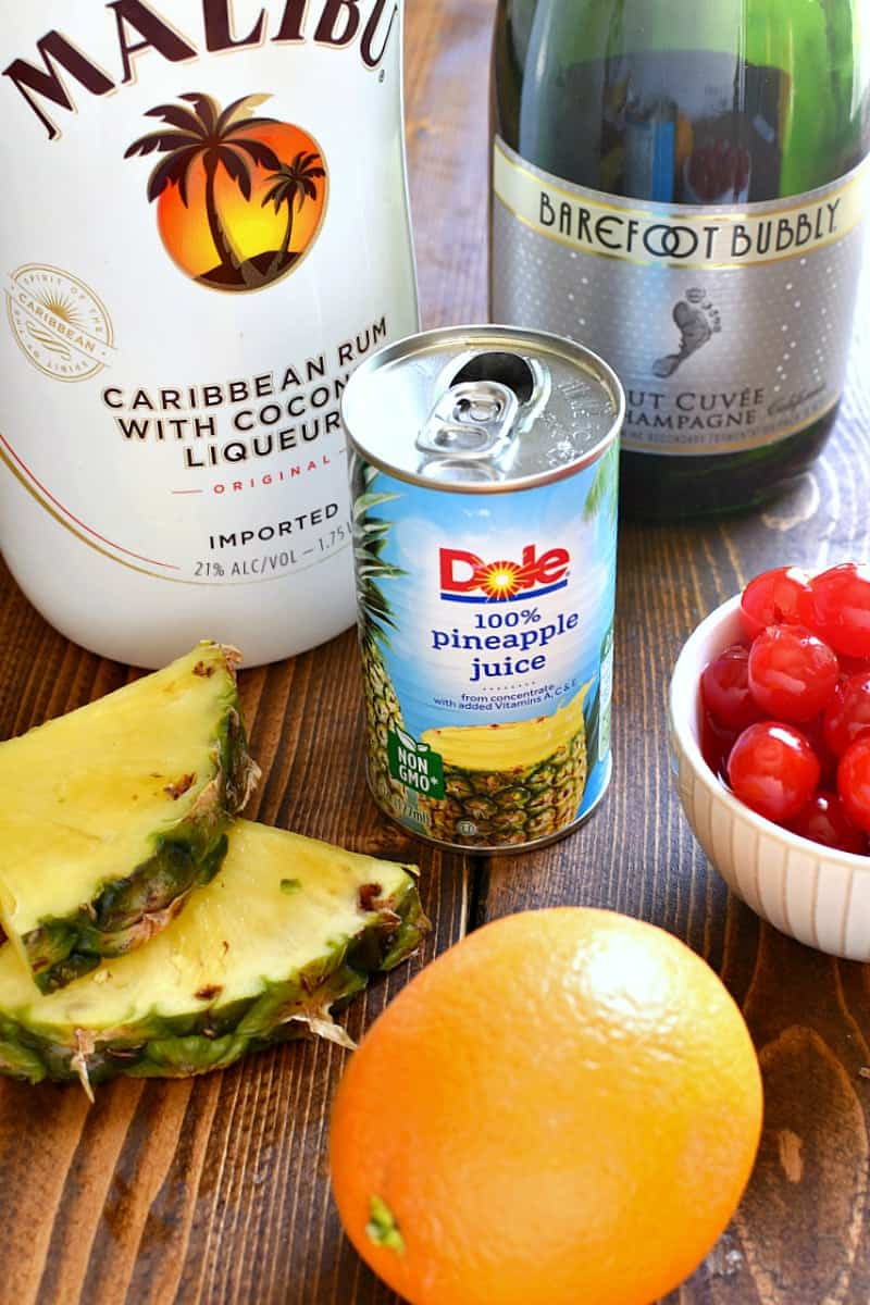 ingredients needed to make Tropical Mimosas - Malibu rum, pineapple juice, and champagne
