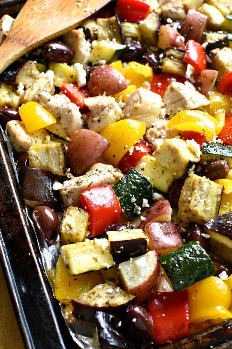 This Sheet Pan Greek Chicken has ALL the best flavors! Loaded with chicken, veggies, kalamata olives, and Greek seasonings, this delicious one pan dinner comes together quickly and feeds a family!