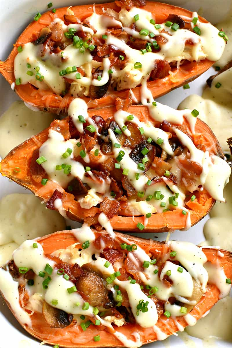 These Loaded Baked Sweet Potatoes make the most delicious dinner! Stuffed with chicken, bacon, mushrooms, swiss cheese, and a creamy cheese sauce, they're easy to make and packed with flavor! Sure to become a new family favorite!