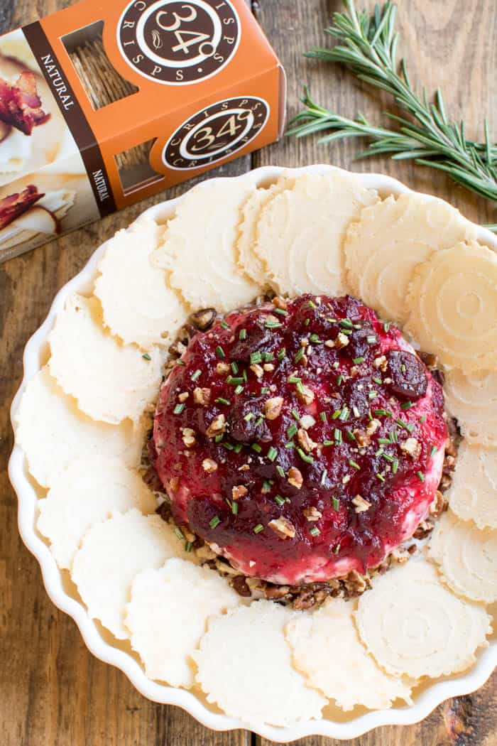 Take cheese & crackers to the next level with this Cranberry Pecan Baked Goat Cheese! Loaded with creamy goat cheese, crisp bacon, chopped pecans, cranberry sauce, and fresh rosemary, this is the ultimate holiday appetizer! The perfect blend of savory and sweet, and the perfect way to elevate your next cocktail party or holiday gathering. Whether you're a seasoned pro or hosting for the first time, this recipe is easy, delicious, and sure to impress. If you love cheese, you'll LOVE this yummy twist on a classic....and so will all your guests!