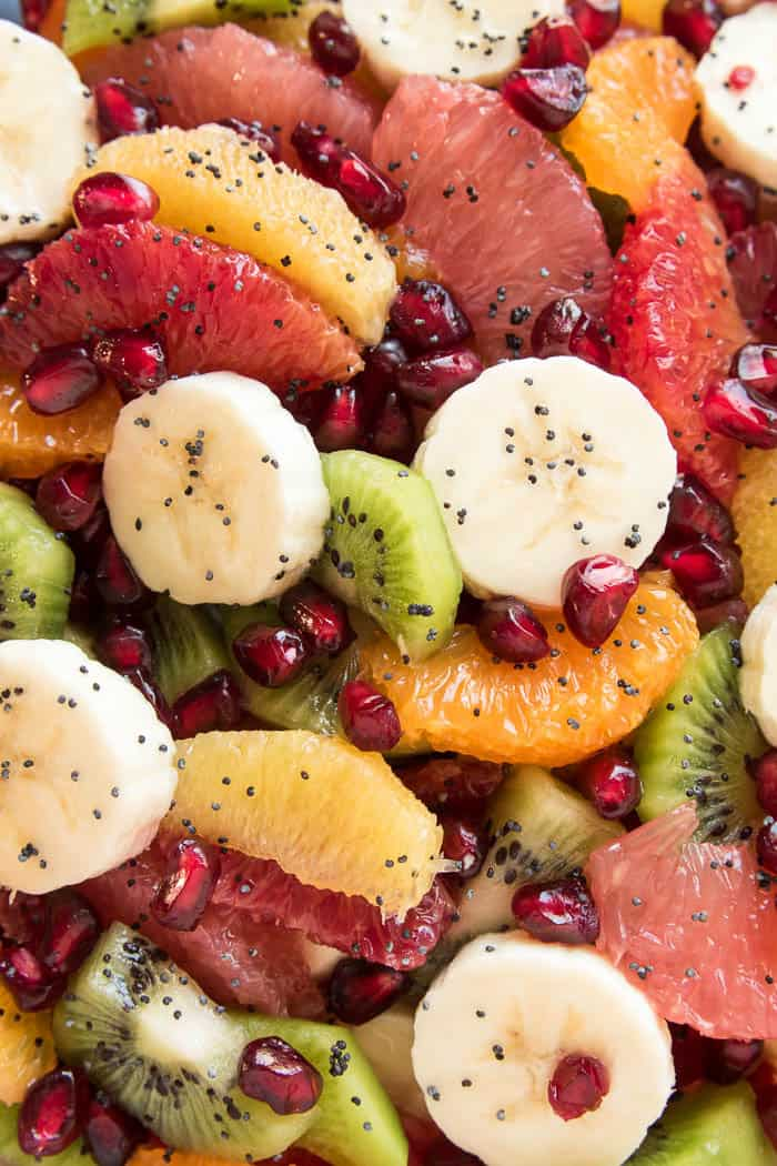 Take advantage of citrus season with this delicious Winter Fruit Salad! Loaded with all your favorite winter citrus fruits, plus bananas, kiwi, and pomegranate seeds, this salad is bright and sweet and guaranteed to help you beat the winter blues. And when you toss it in a sweet orange poppy seed simple syrup, the end result is a fruit salad you want to eat again and again, all winter long. Perfect for breakfast, lunch, or any meal in between, this salad is as healthy as it is delicious....and so pretty, too! Which makes it the ideal side dish for any special occasion. No matter how you slice it, this Winter Fruit Salad is guaranteed to become new favorite and sure to be the star of the show!