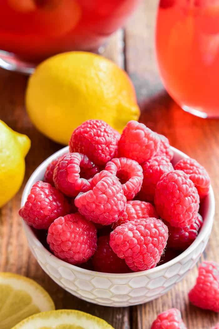 Lemon Raspberry Sangria is the perfect way to welcome in spring! This fruity sangria starts with rose wine and raspberry lemonade and is packed full of fresh raspberries and lemon slices. Ideal for Mother's Day, ladies' nights, or sunny days by the pool. If you love sangria, you'll love this refreshing twist!