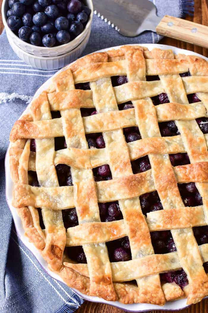 This Easy Blueberry Pie is one of our favorite summer desserts! It's simple to make, with just a handful of ingredients, and packed with the sweet taste of fresh blueberries. This pie is perfect for summer picnics or parties, and it comes together in no time at all. You can serve it as is, straight from the pan, or with a scoop of vanilla ice cream for a summer treat that's sure to be a hit!