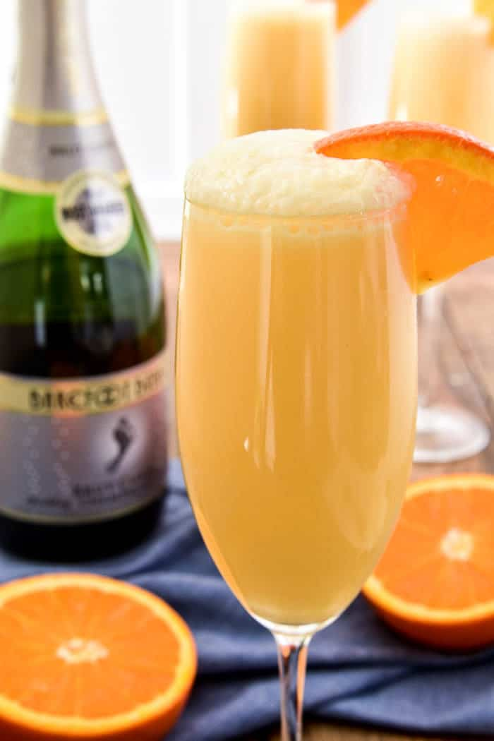 Take your favorite breakfast cocktail to the next level with these delicious Orange Creamsicle Mimosas! They combine the fun of childhood with the deliciousness of adulthood....all in one glass. Made with 4 simple ingredients, these mimosas are just the right blend of creamy, sweet, and bubbly. Perfect for weekend brunches, ladies' nights, or lazy days by the pool. If you love mimosas (and who doesn't!?) you'll love this fun, creamy, YUMMY twist!