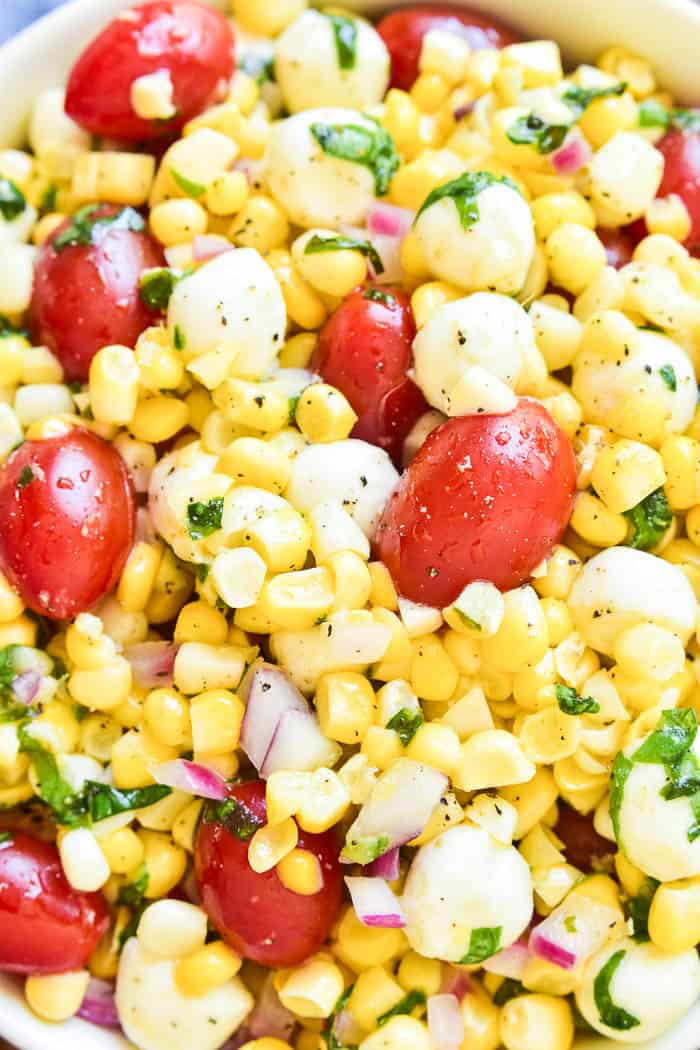 This Caprese Corn Salad combines some of the BEST flavors of summer in one delicious side dish! Fresh sweet corn meets the classic flavor combination of tomatoes, basil, and fresh mozzarella. Dressed in a light vinaigrette, this salad is the perfect side dish for any meal. It can be enjoyed all on its own or topped with grilled chicken or shrimp for a light yet satisfying dish. If you love caprese salad, you'll love this easy, flavorful summer twist!