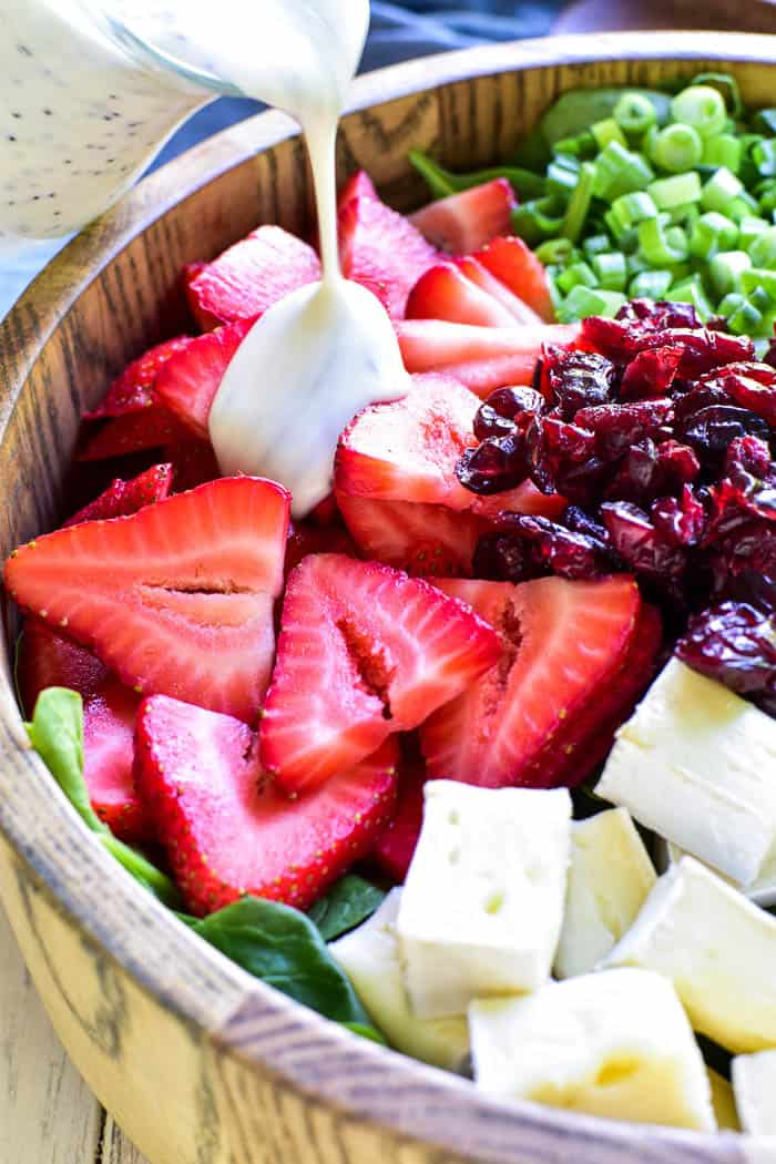 This Strawberry Brie Spinach Salad is one of our favorites! Made with fresh spinach, sliced strawberries, dried cranberries, pecans, and brie cheese, this salad is the perfect combination of savory, sweet, creamy, and delicious. It makes a great lunchtime salad and can be topped with chicken or shrimp for a more satisfying dinner. And....it's equally delicious as a fresh, unique side dish for any meal.