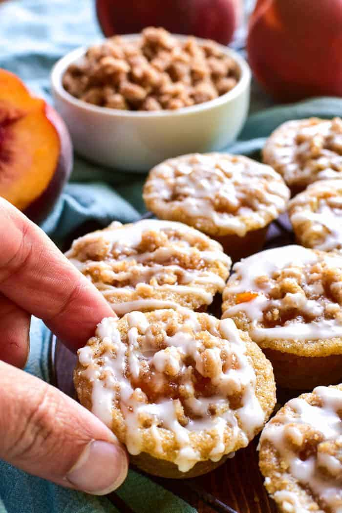 These Peach Cobbler Cookie Cups are the most delicious little bites! Made with a sugar cookie base and topped with peach pie filling and streusel topping, these cookies cups are easy to make and so tasty. Perfect for end of summer parties, lunchbox treats, or your last minute barbecue....if you love peach cobbler you'll go crazy for this bite sized alternative!