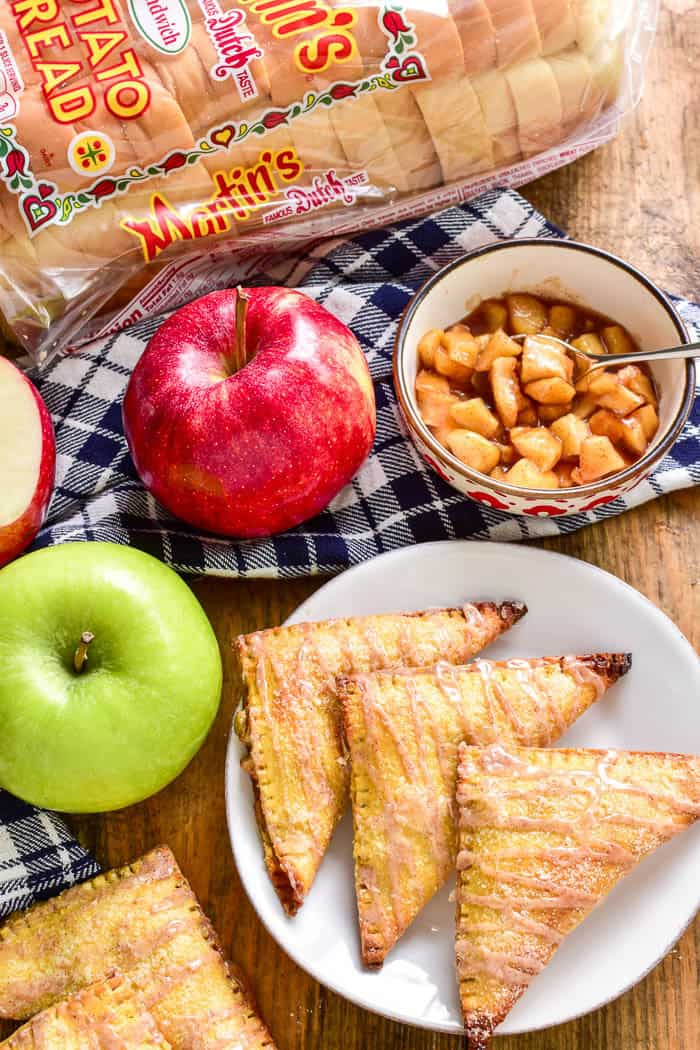 Apple Pie meets Baked Brie in these delicious Apple Brie Turnovers. Stuffed with homemade apple pie filling and creamy brie cheese, they're the perfect combination of savory and sweet. These turnovers make a delicious breakfast, snack, or dessert, and they're fun to eat & easy to make. If you love apple turnovers you'll love this unique, savory twist!