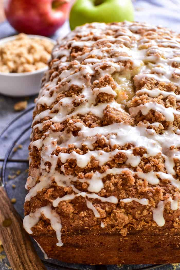 Welcome in fall with this easy Apple Pie Bread! This quick bread combines fresh chopped apples with brown sugar cinnamon streusel and a sweet cinnamon glaze.It comes together in no time and bakes up into a delicious treat no one can resist. Perfect for breakfast, snack, or even dessert....if you love apple pie, you'll fall in love with this Apple Pie Bread!