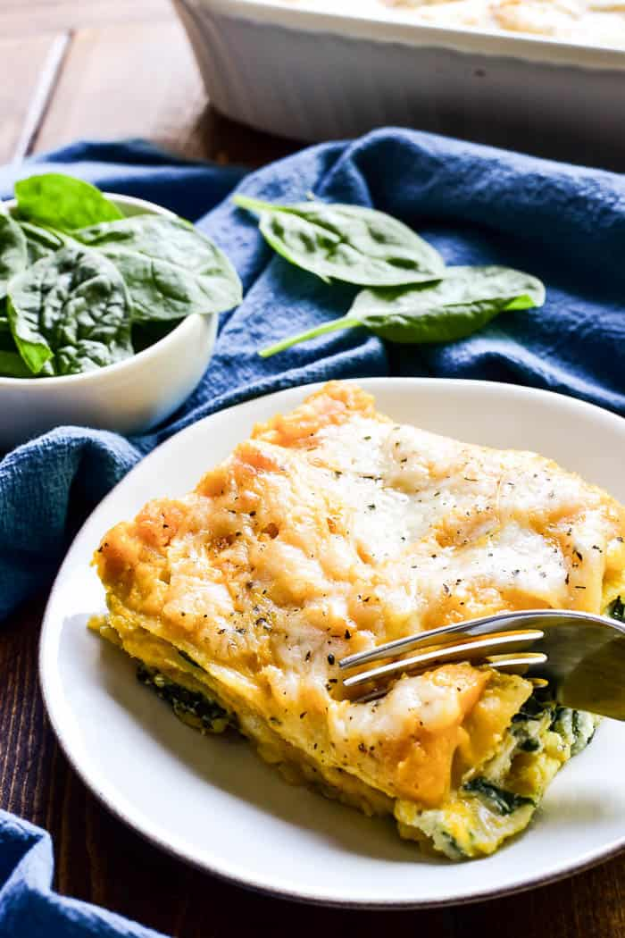 This Butternut Squash Lasagna is the ultimate fall comfort food. It combines layers of creamy ricotta, butternut squash, fresh spinach, and gooey mozzarella in a cheesy lasagna that everyone is sure to love. This dish is easy to make ahead and perfect for busy weeknights or weekend family meals. And it would make a delicious addition to any holiday menu!